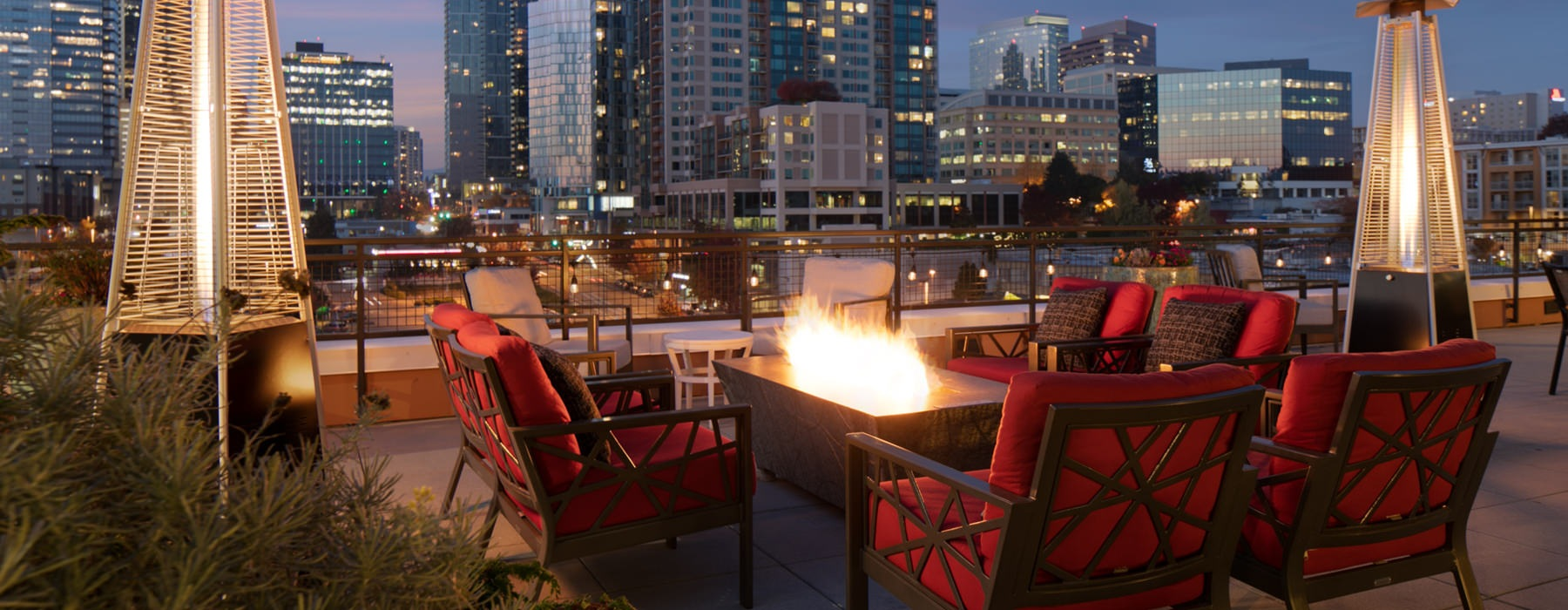 rooftop terrace with firepit at night